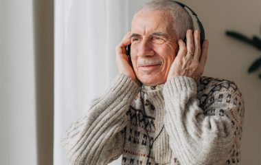 old man with headphone