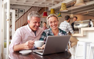 a couple watching video in a coffee shop
