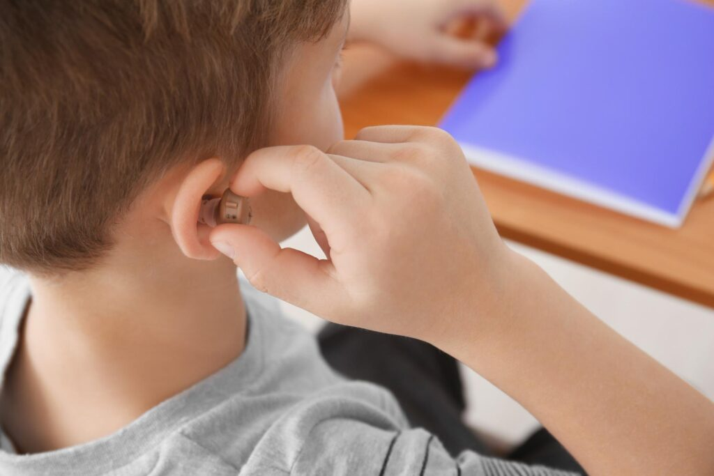 kid with hearing aids