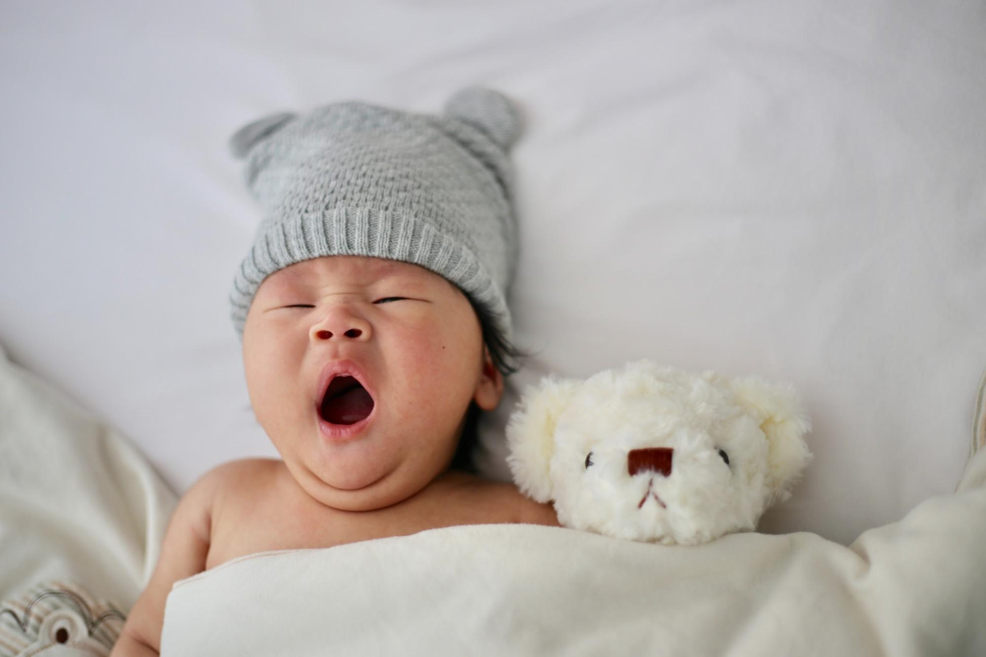 baby with toy bear